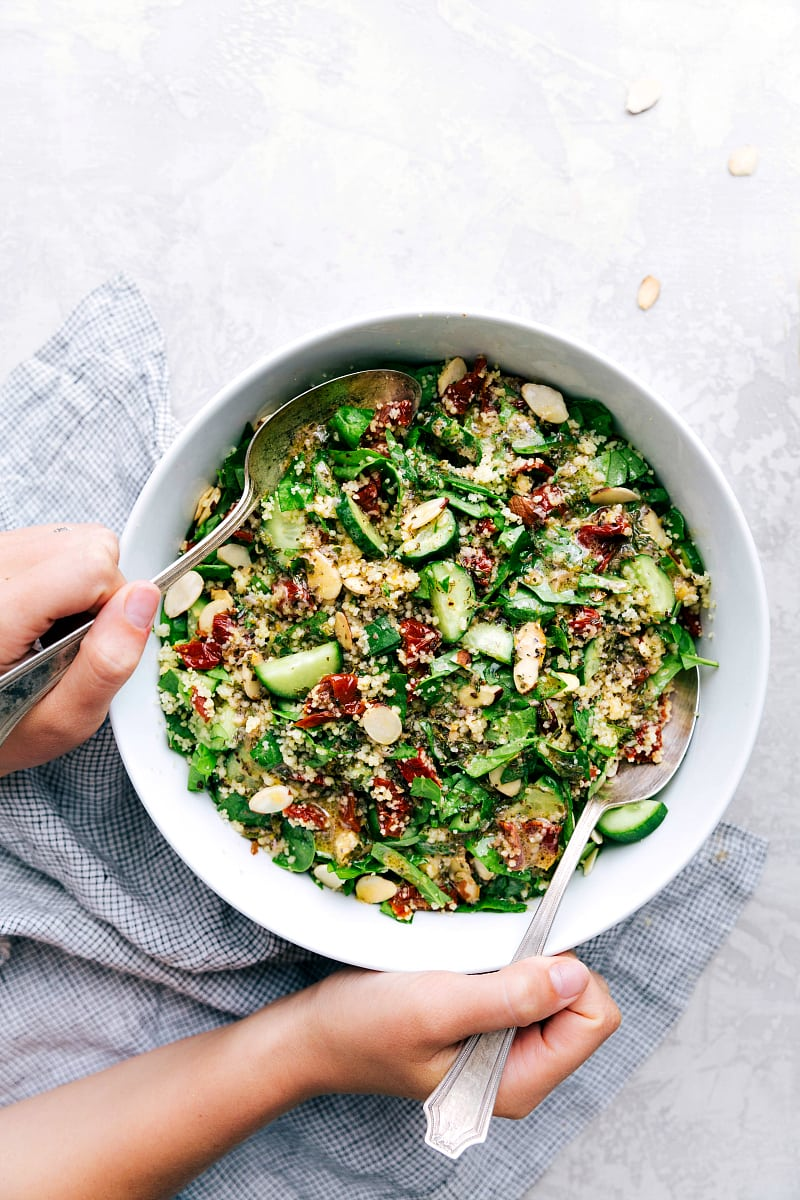 A delicious, flavor packed, and healthy couscous salad with sun dried tomatoes, toasted almonds, and cucumber dressed in a flavorful lemon vinaigrette