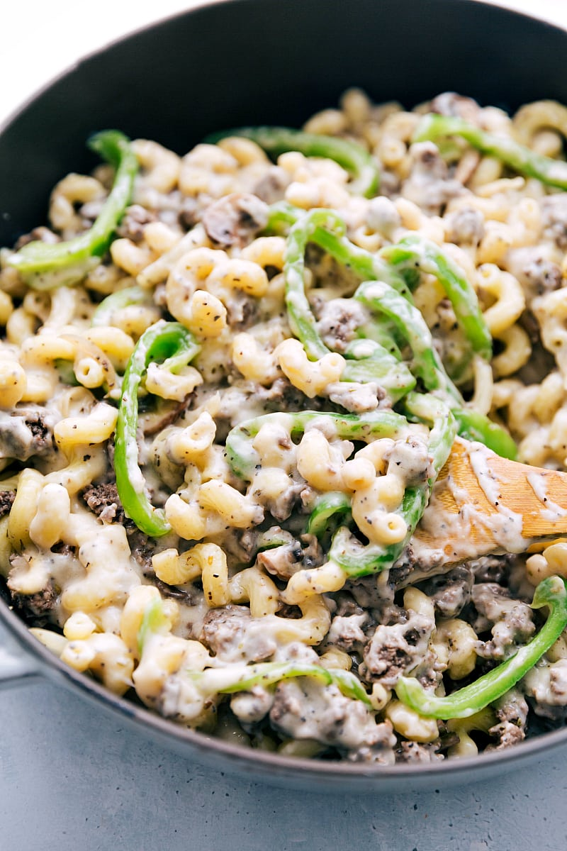 Up close shot of pot filled with philly cheesesteak pasta