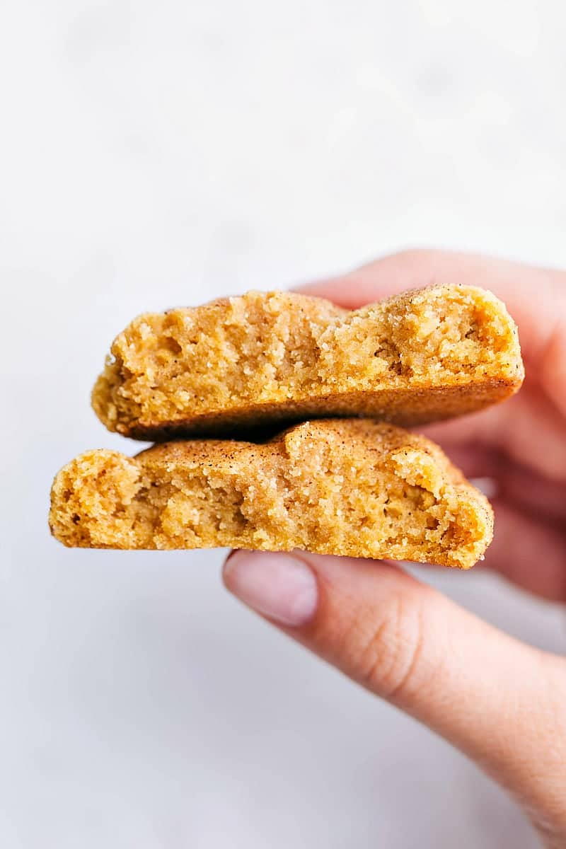 Close up shot of a pumpkin snickerdoodle broken in half to see the soft and chewy interior