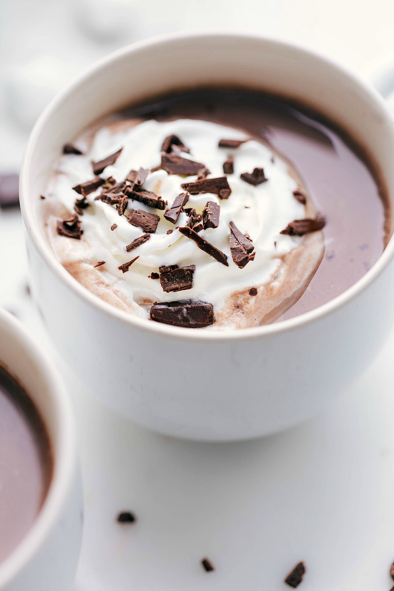 Hot Chocolate with melting whipped cream and chocolate shavings on top