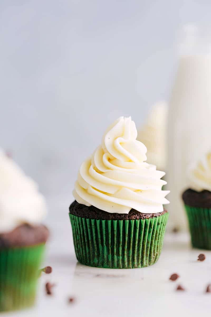Up close photo of cupcakes frosted with cream cheese frosting