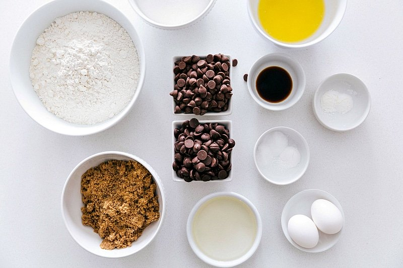 Ingredient shot of all the components of this recipe--flour, brown sugar, butter, coconut oil, eggs, chocolate chips, etc.