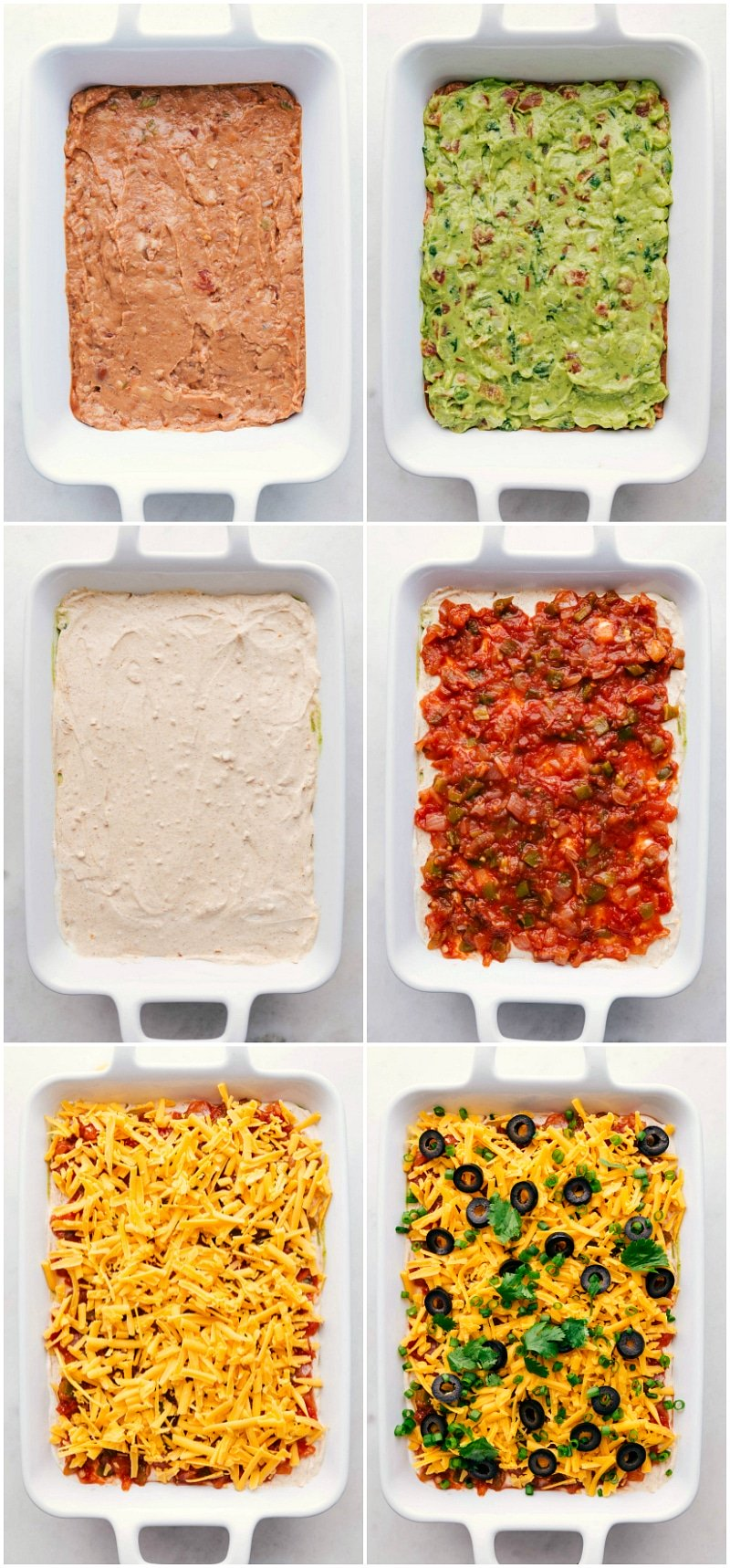 Overhead image of the refried beans, guacamole, sour cream with taco seasoning, salsa, cheese, olives, and green onion layers for this 7 layer dip recipe.