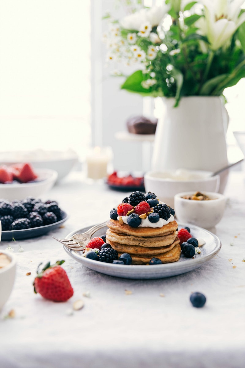 Image of the ready to eat homemade pancakes with whipped cream and fruit topping
