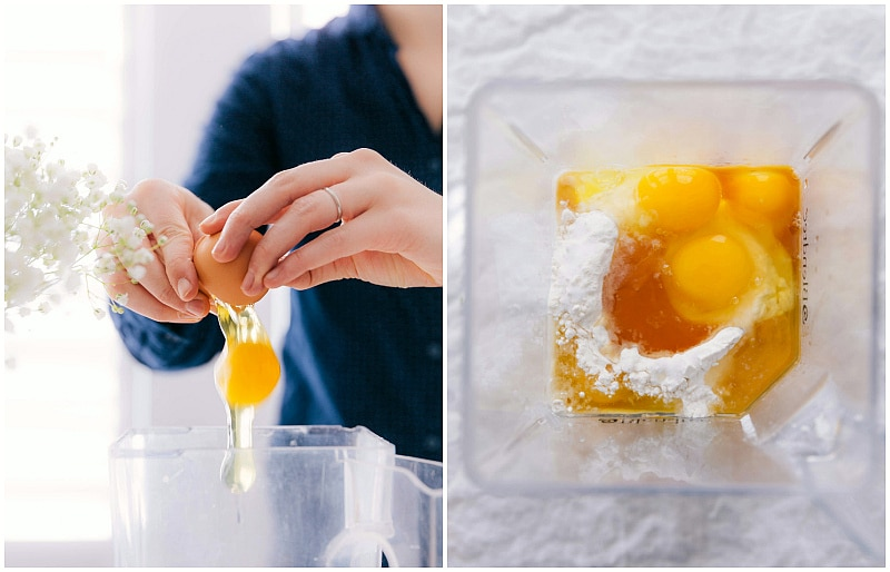 Breaking eggs and adding them to the blender, along with other ingredients.