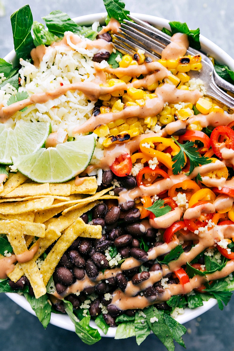 Overhead image of the ready to eat black bean and corn salad with the dressing on it