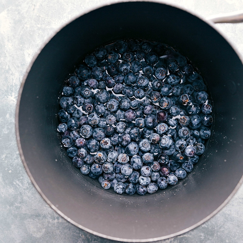 Image of the fresh berries being added to a sauce pan