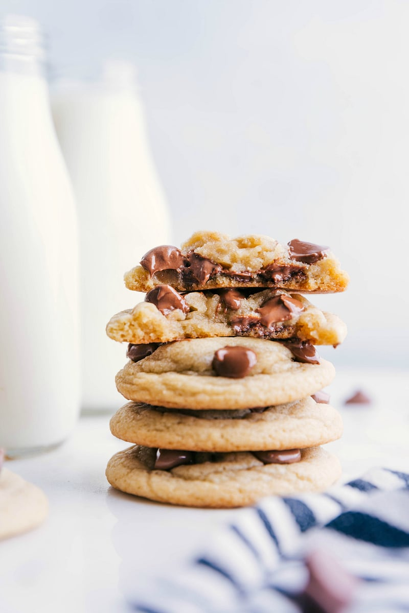 Stack of Chewy Chocolate Chip Cookies with one cookie broken in half to show the chewy center.
