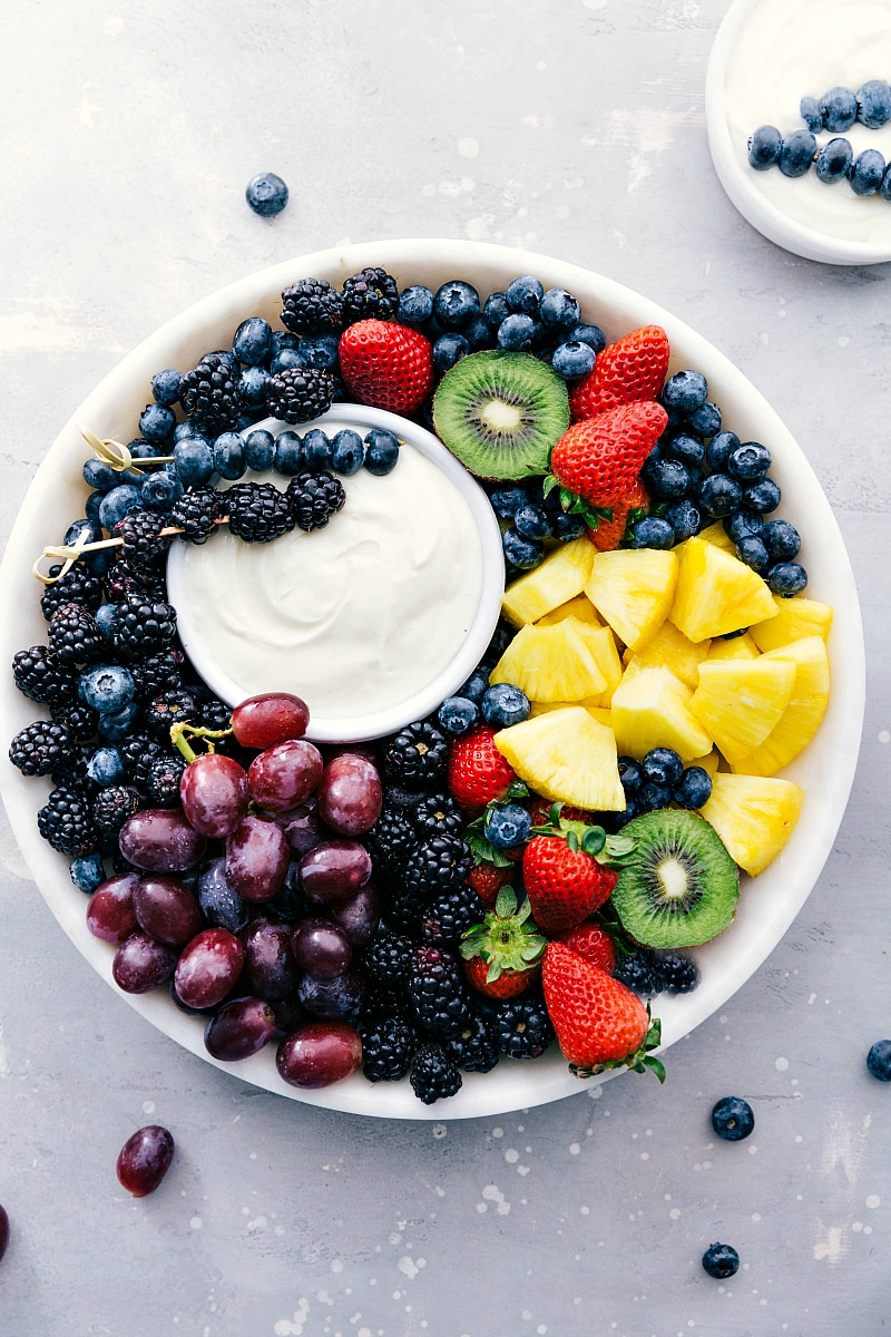 Image of the ready-to-eat Fruit Dip with a variety of fruit around it on a platter.