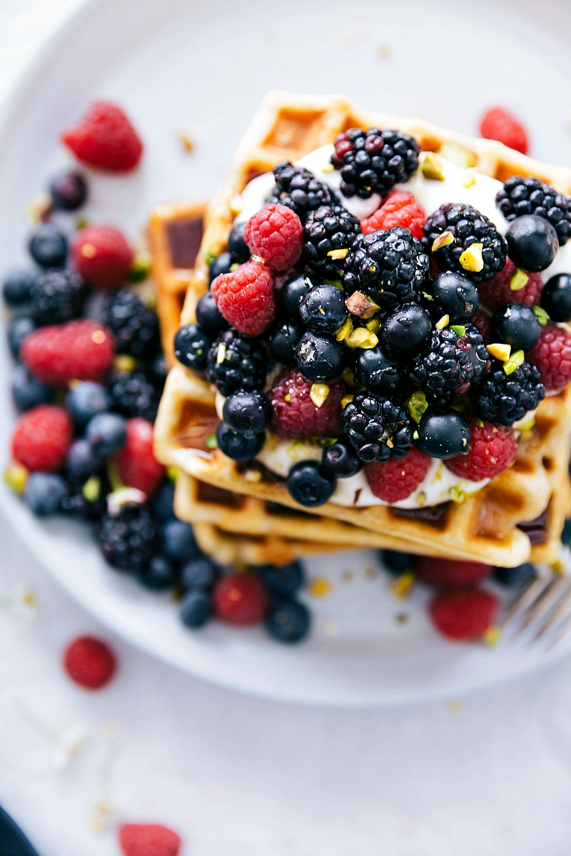 Overhead image of the cooked waffles stacked with berries on top