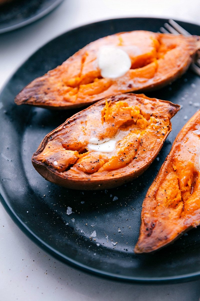 Up close image of the baked sweet potato recipe fresh out of the oven with melted butter on top
