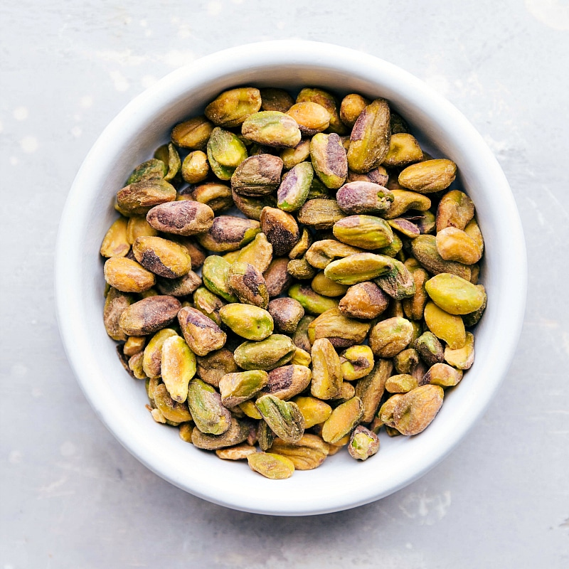 Overhead image of the fresh pistachios in a bowl