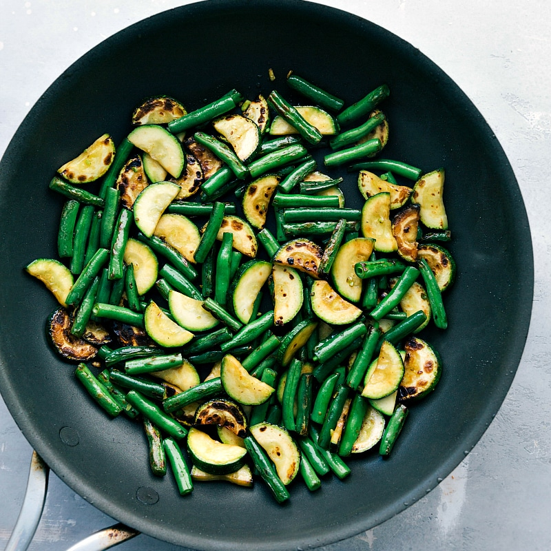Process shot-- image of the zucchini and green beans cooked in the sauce pan