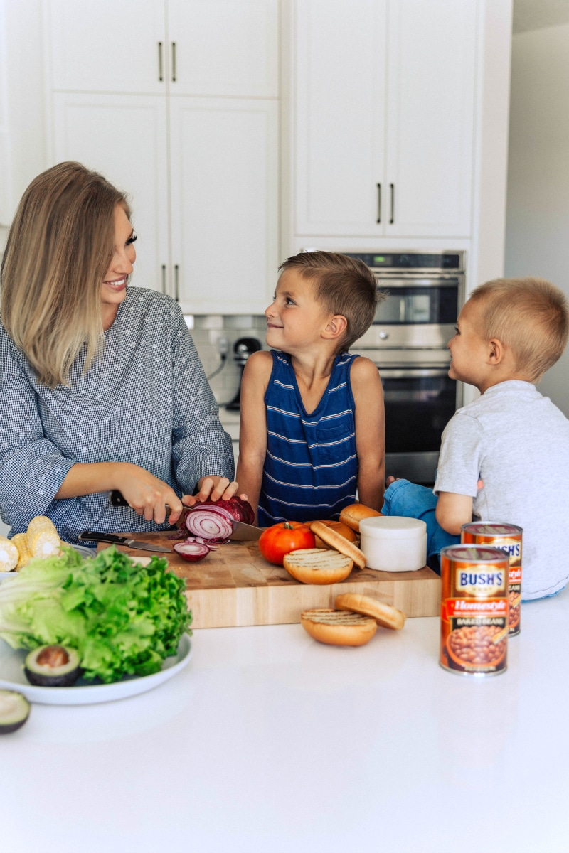Image of Chelsea and her boys assembling the chicken burgers