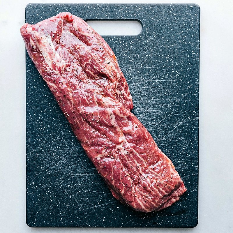 Image of the raw flat iron steak on a cutting board