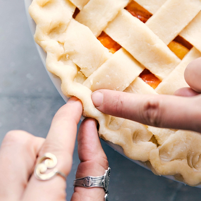 Image of the pie crust being shaped over the pie.