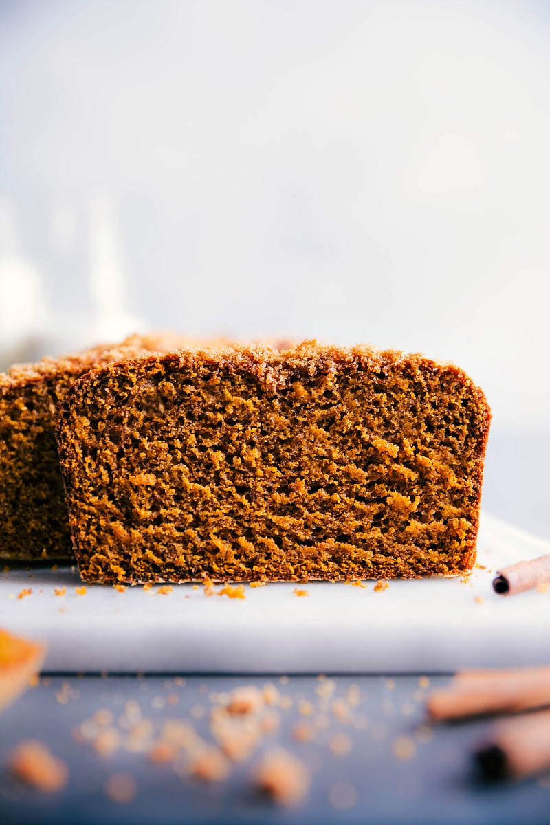 Image of a slice of pumpkin bread cut out from the main loaf