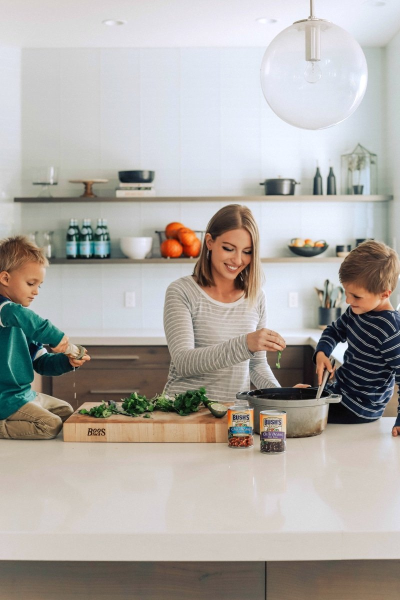 Process shot-- image of Chelsea and her boys making the chili with black beans and sweet potatoes