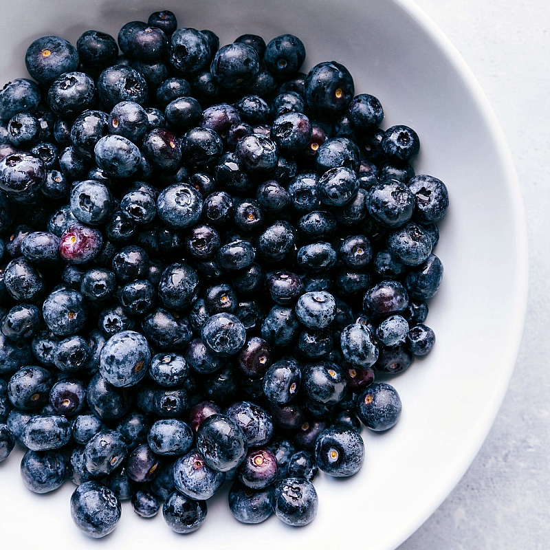 Image of the fresh blueberries in a bowl for this blueberry crisp recipe