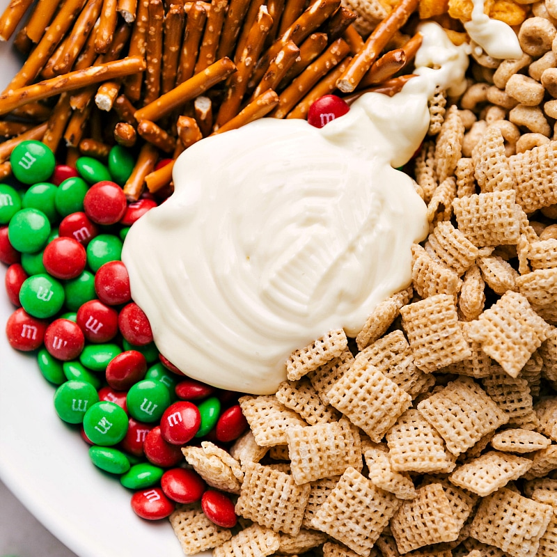 Image of the white chocolate on the ingredients in this Christmas Chex mix snack