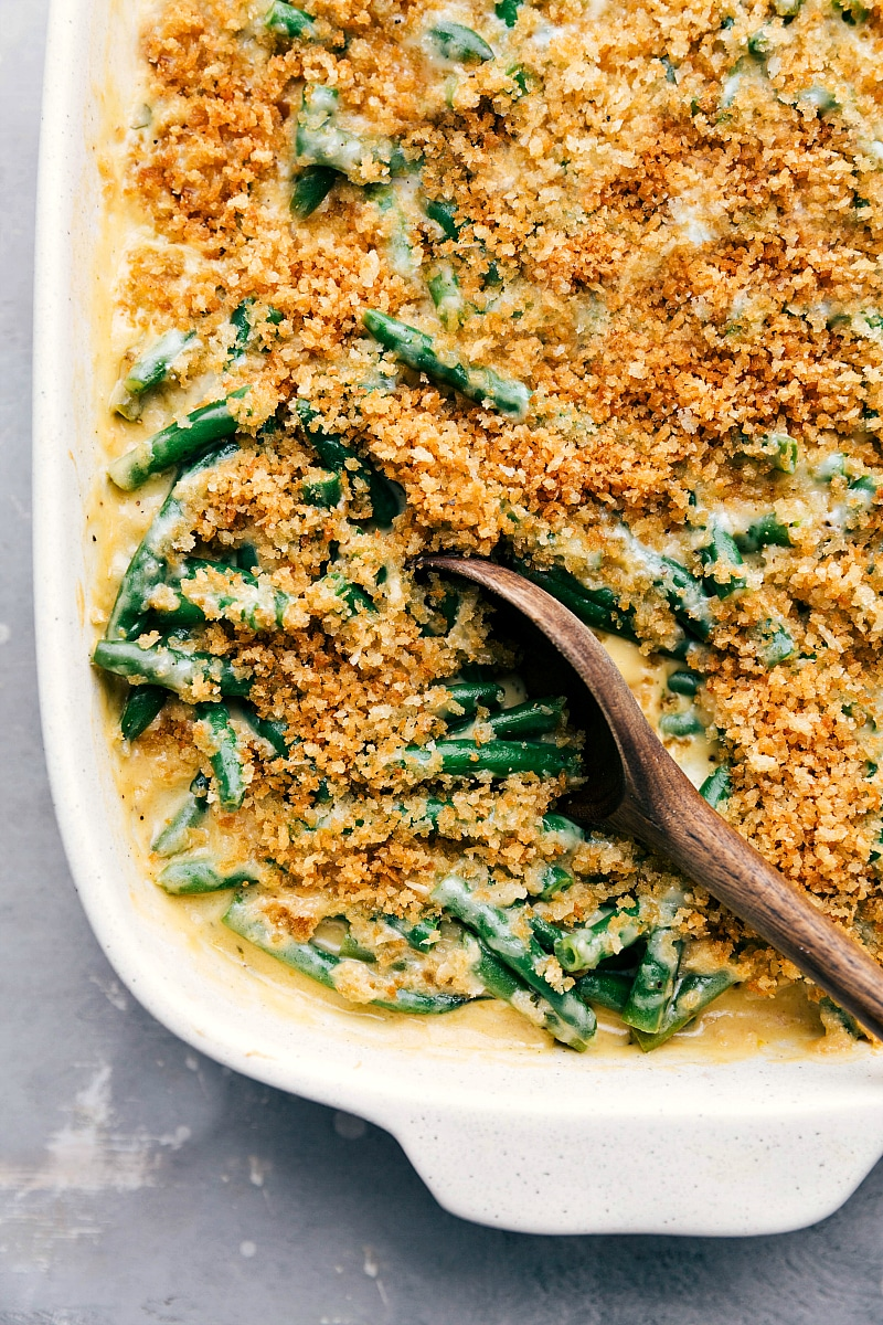 Image of the ready-to-eat Green Bean Casserole with a spoon in the pan.
