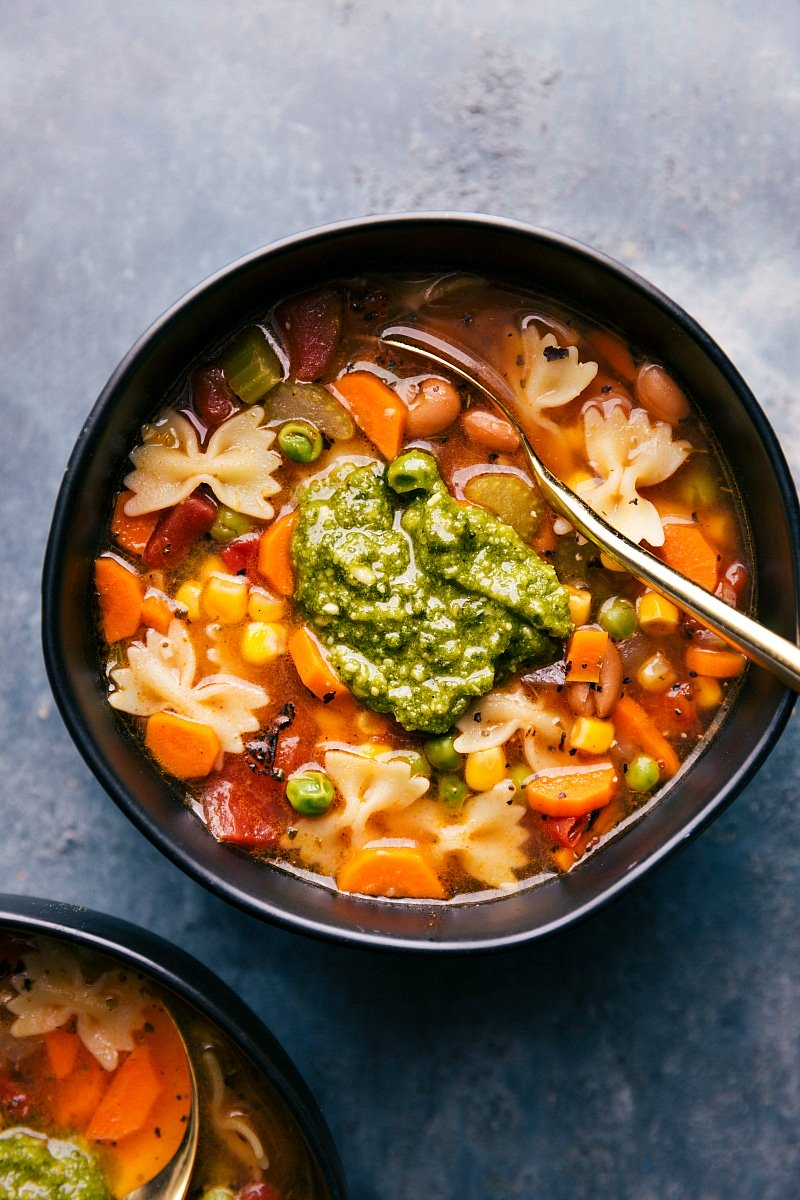 Overhead image of the vegetable soup with pesto on top ready to be eaten
