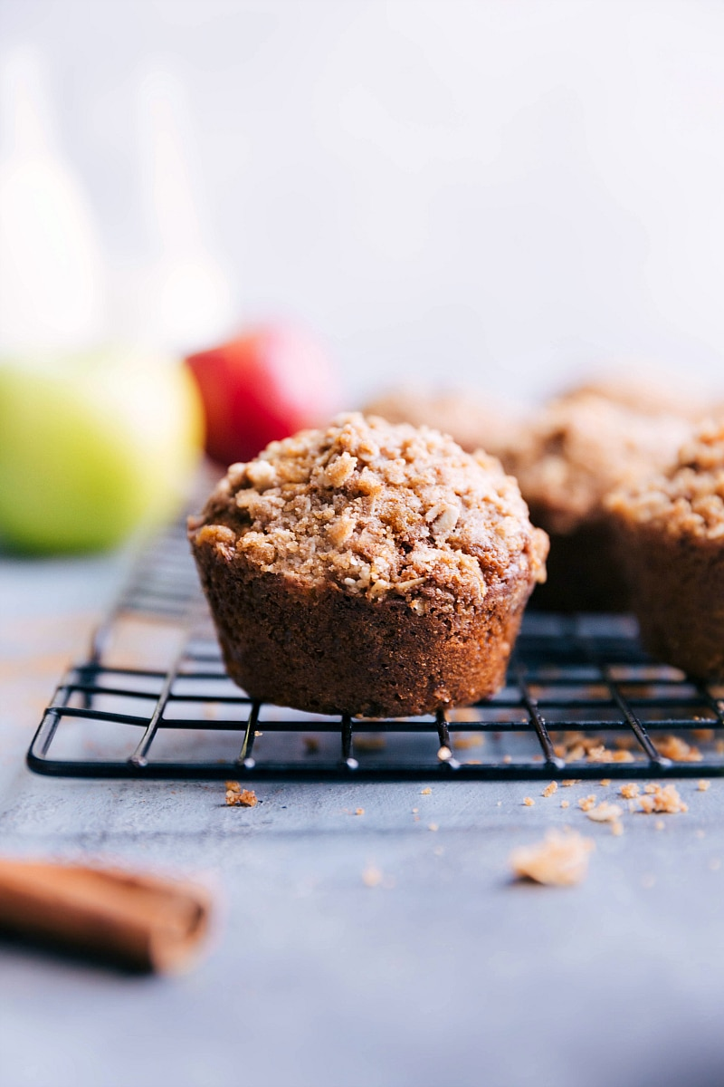 Image of Apple Muffins fresh out of the oven, sitting on a cooling rack.