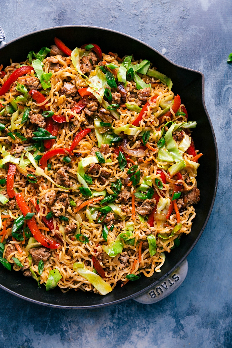 Finished Egg Roll Noodles in a large skillet garnished with green onions.