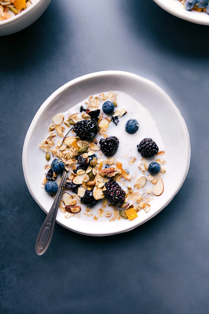 Overhead view of Muesli with milk and berries.
