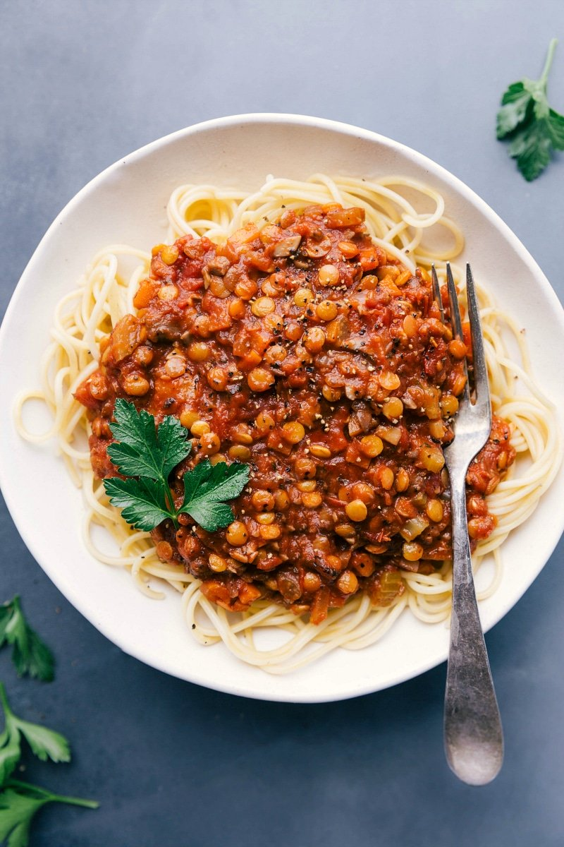 Overhead view of Lentil Bolognese on a bed of spaghetti.