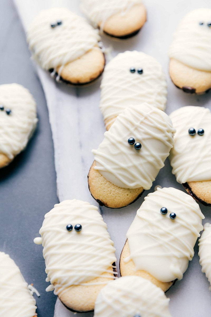 Images of the mummy cookies laid out on a board