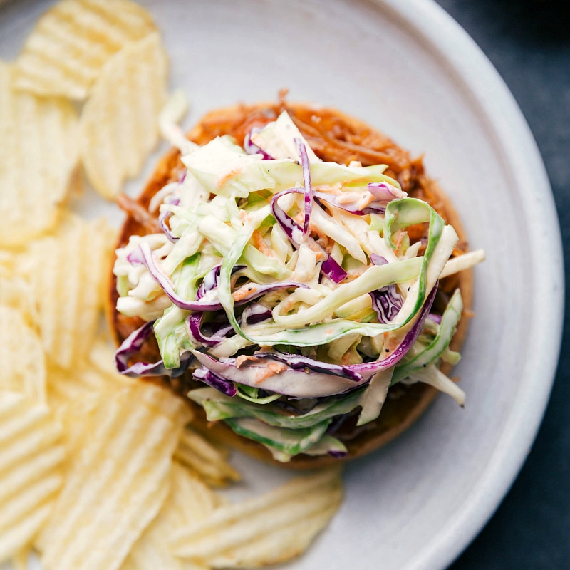 Overhead image of Coleslaw on a pulled pork sandwich.