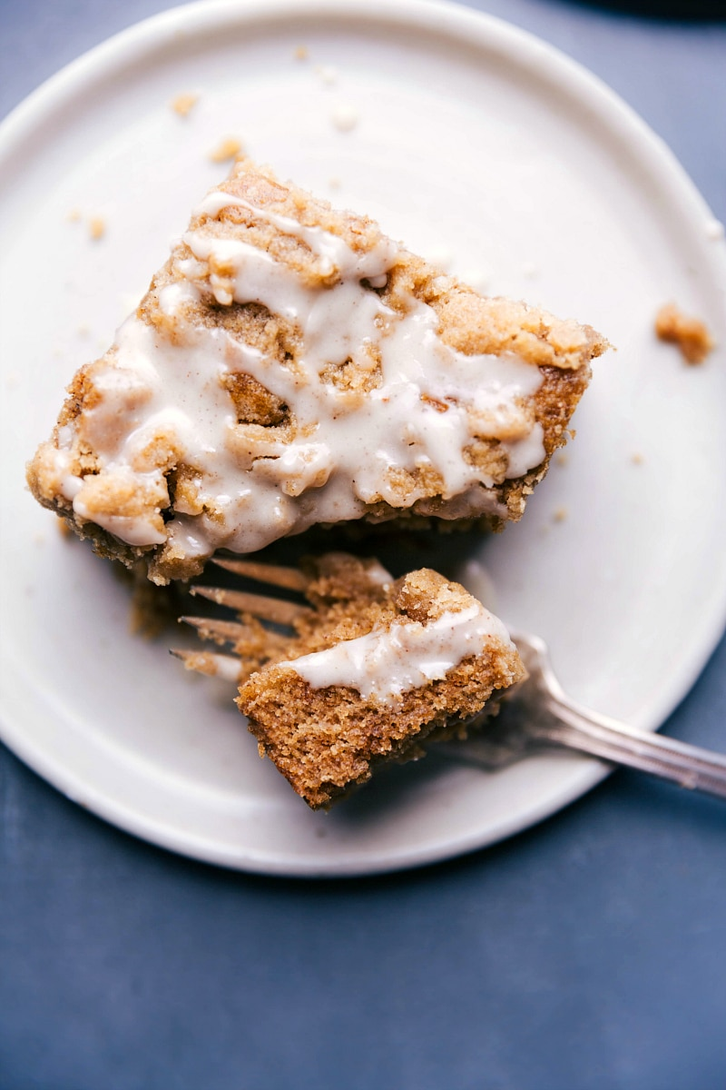 Overhead image of Apple Coffee Cake on a plate with a bite being taken out of it.