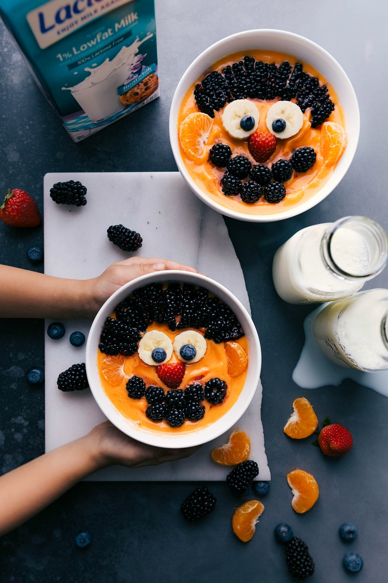 Overhead image of two of the peach smoothie bowls with Sesame Street Character Ernie on them