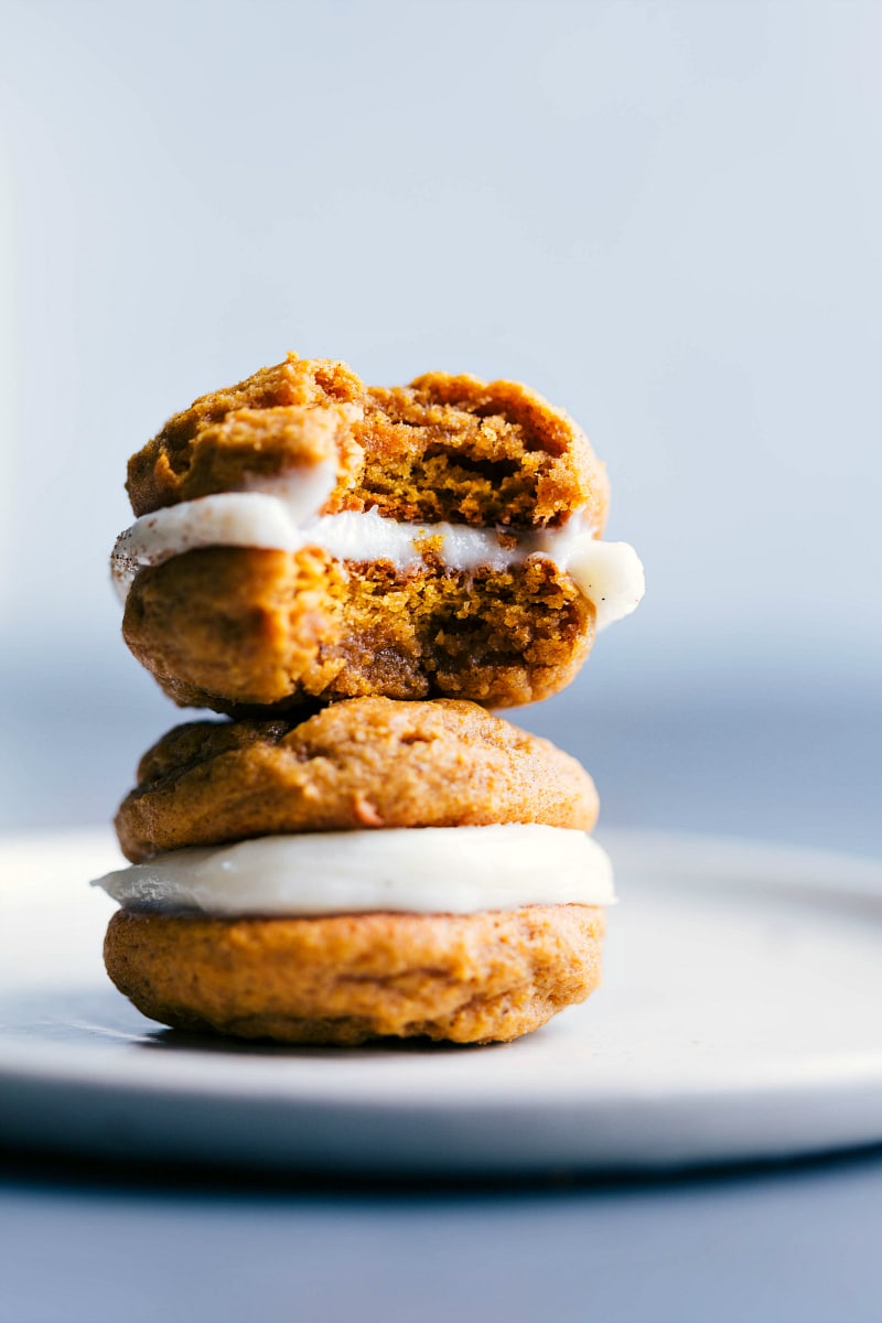 Image of two Pumpkin Whoopie Pies stacked on top of each other.