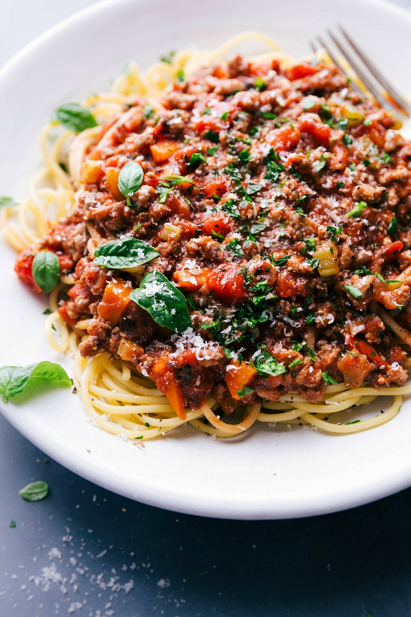 View of a plate of spaghetti topped with Turkey Bolognese.