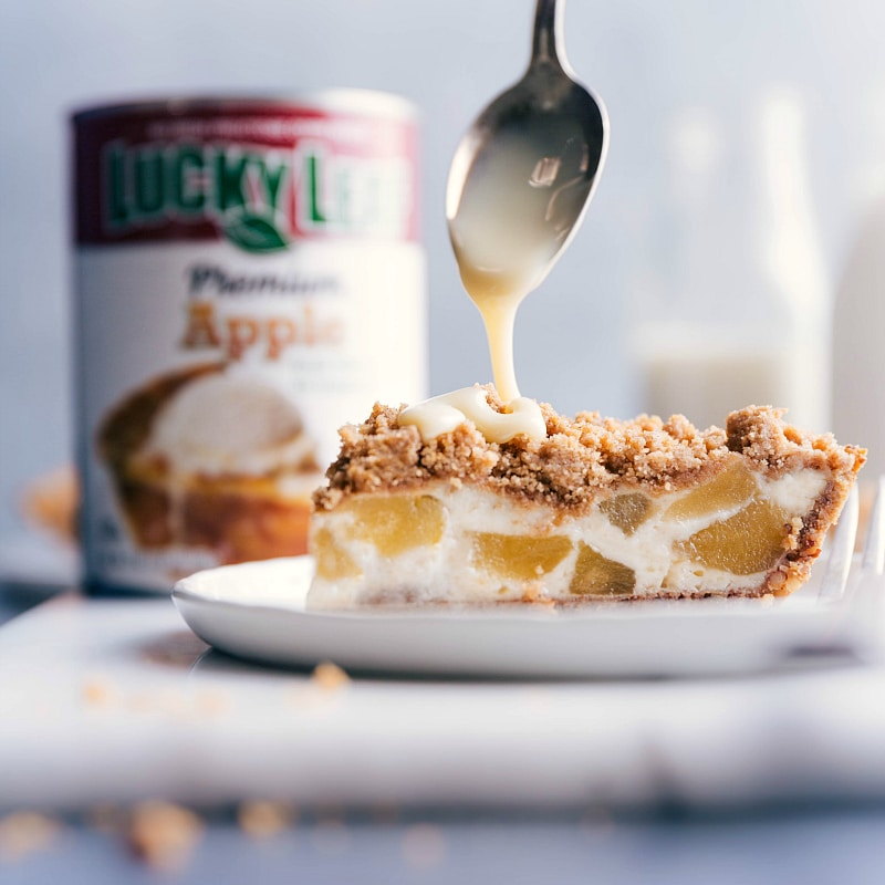 Image of a spoonful of sweetened condensed milk being drizzled over the baked pie.