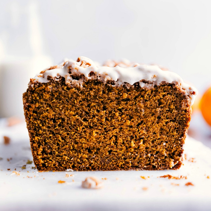 Up-close image of Pumpkin Bread with Streusel Topping and the glaze freshly added on top.