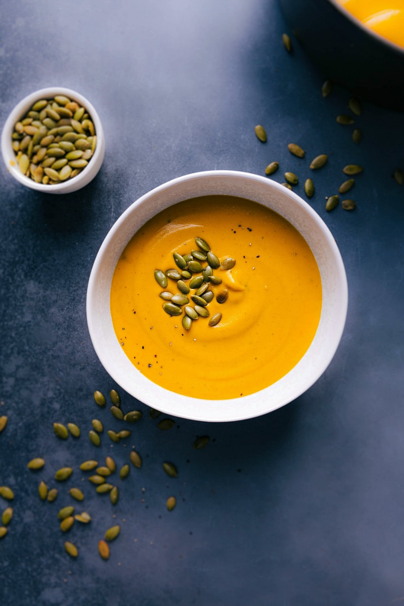 Overhead view of Sweet Potato Soup and pepitas for topping.