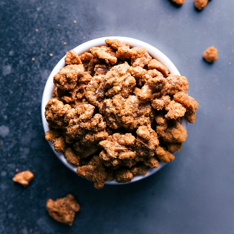 Overhead view of a bowl of Candied Walnuts.