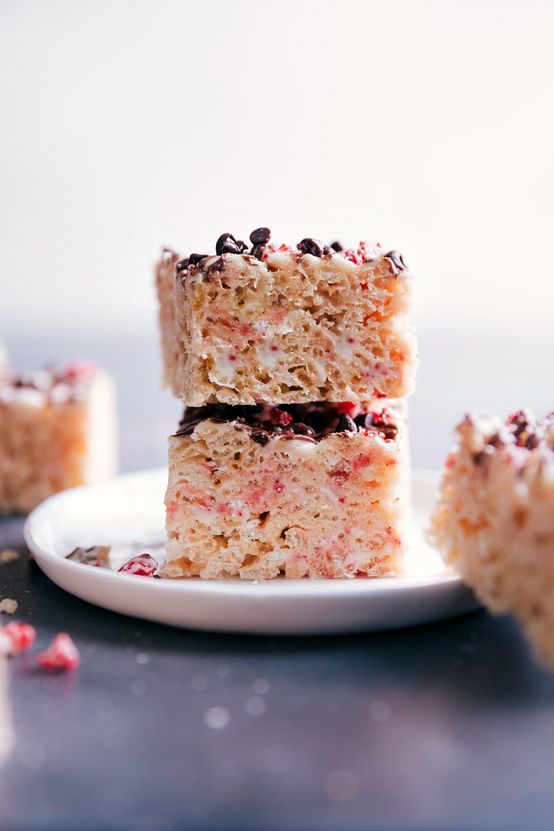 View of two Peppermint Rice Krispie Treats stacked on a plate.