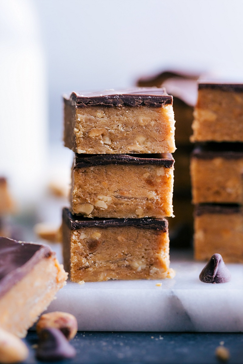 View of several pieces of Buttercrunch Candy stacked on a board.