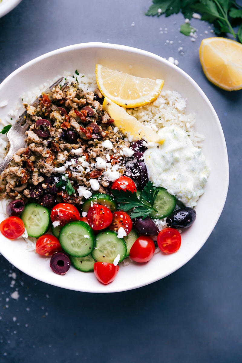 Up-close overhead image of the Greek Ground Turkey bowls with all the toppings, ready to be served.