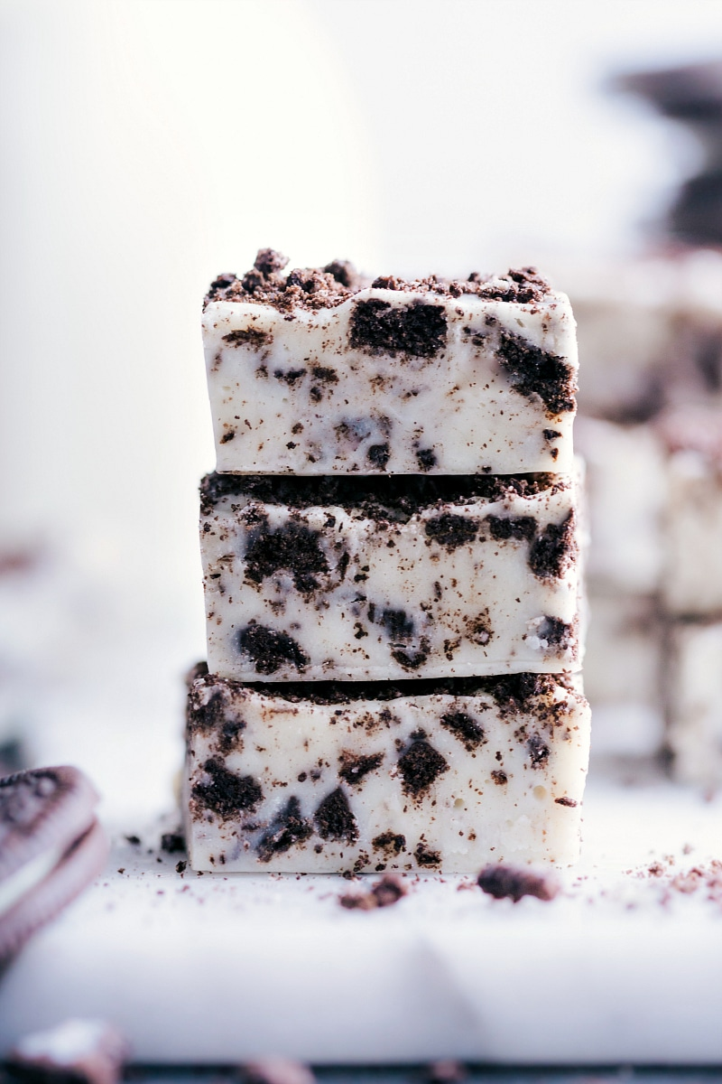 Close-up image of a stack of three pieces of Oreo Fudge.