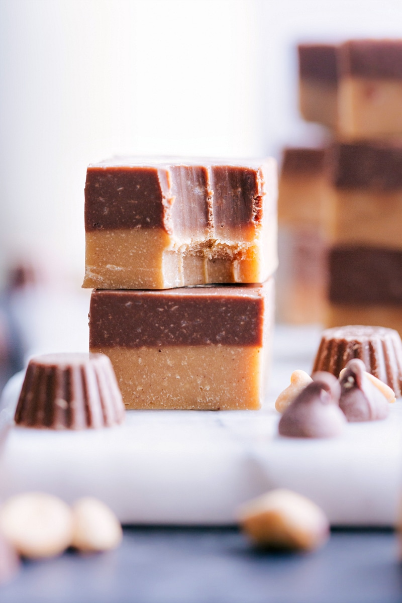 Image of two pieces of Reese's Fudge stacked, with the top one partially eaten.