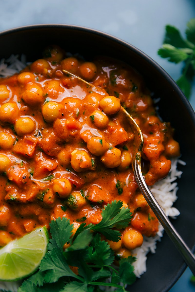 Close-up view of a plate of Chickpea Curry over basmati rice.