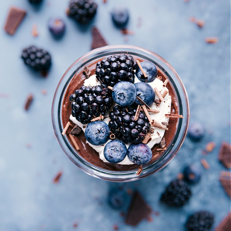 Chocolate Chia Seed Pudding with whipped cream and fresh berries on top