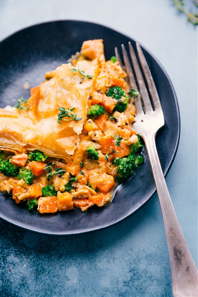 Up close overhead image of the Broccoli Cheddar Pot Pie on a plate ready to be eaten
