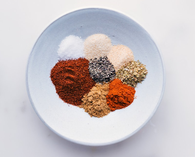 Process shots-- images of all the seasonings in a bowl compartmentalized